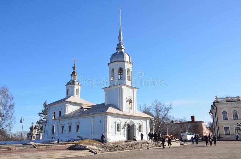 Vologda, Russia, March, 09,2014. Russian scene: people walking near the church of Alexander Nevsky on Kremlevskaya square in Volog. Vologda, Russia. Russian stock image