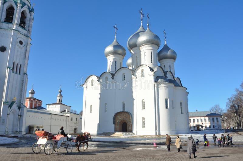 Vologda, Russia, March,09,2014. Russian scene: People walking near Sophiysky cathedral in Vologda Kremlin in early spring. Vologda, Russia. Russian scene: People stock image