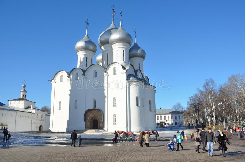 Vologda, Russia, March,09,2014. Russian scene: People walking near Sophiysky cathedral in Vologda Kremlin in early spring. Vologda, Russia. Russian scene: People stock images