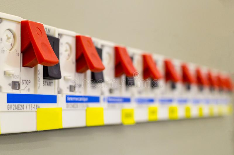 Voltage switchboard with circuit breakers. Electrical background stock image