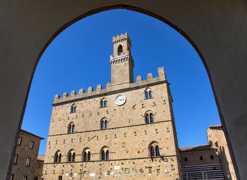 Volterra town central square, medieval palace Palazzo Dei Priori landmark royalty free stock photography