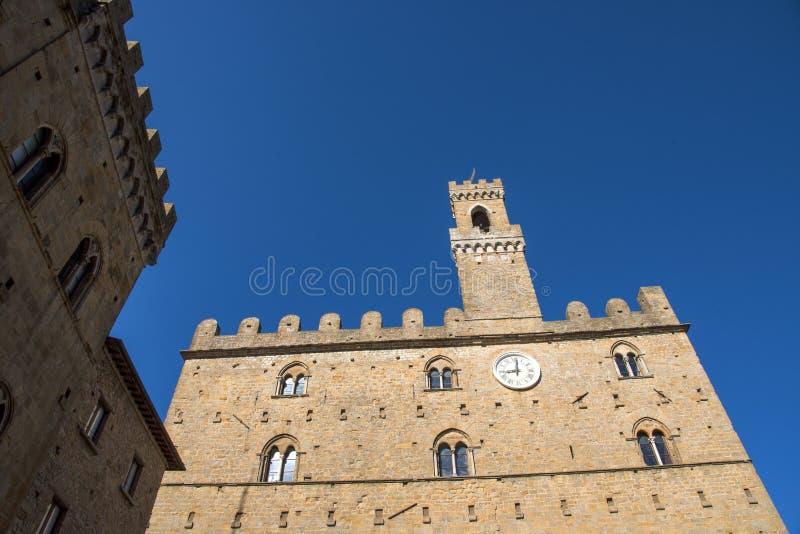 Volterra town central square, medieval palace Palazzo Dei Priori landmark. Pisa state, Tuscany, Italy, Europe stock photo