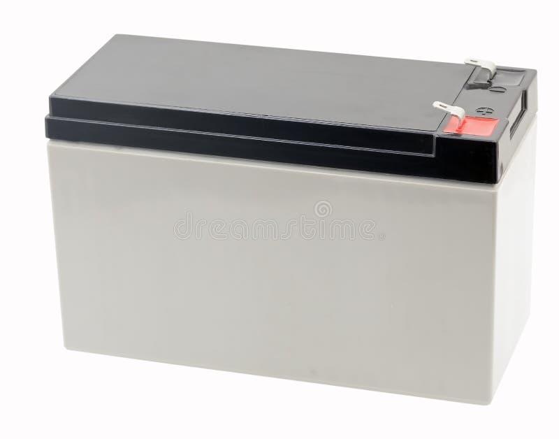 12 voltios de batería aislada en blanco imagenes de archivo