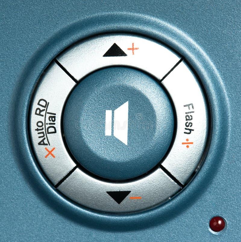 Volume button. On the digital telephone macro stock image