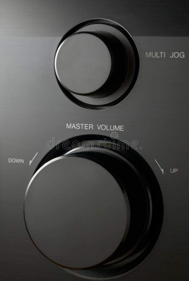 Volume control. Round master volume button close-up royalty free stock image
