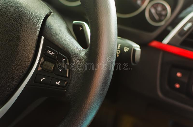 Volume keys on the steering wheel. Close up of volume control switch volume keys on the steering wheel stock images