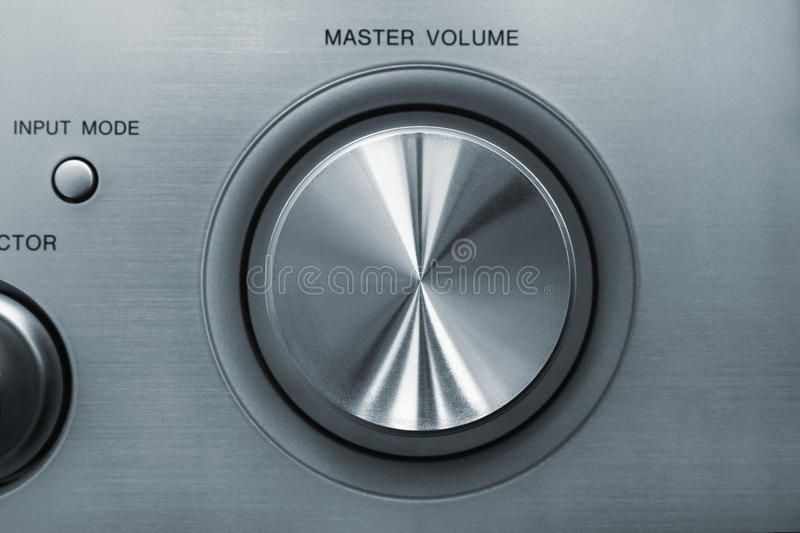 Volume knob. Detail front view of master volume knob located on audio video receiver stock photography