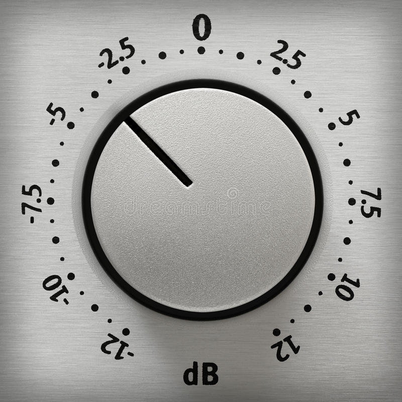 Volume knob close-up. Studio closeup of a metallic volume knob with numbers from -12 to 12 dB stock photo