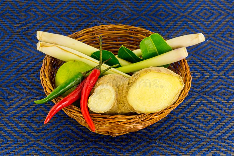 Volume of yam spicy soup ingredient vegetables vegetarian traditional dish of Thailand on a blue background in a wicker basket royalty free stock photos