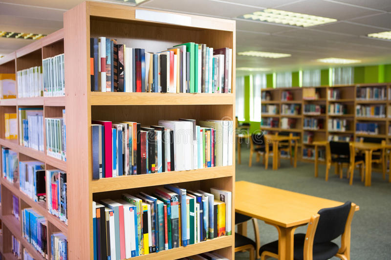 Volumes of books on bookshelf in library. At the university stock photo