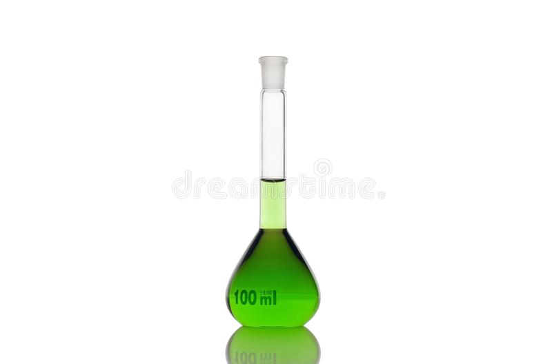 Volumetric flask with green liquid on white background royalty free stock images