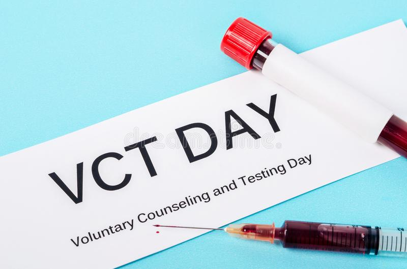 Voluntary counseling and testing day. Voluntary counseling and testing day with blood in tube and syringe royalty free stock photo