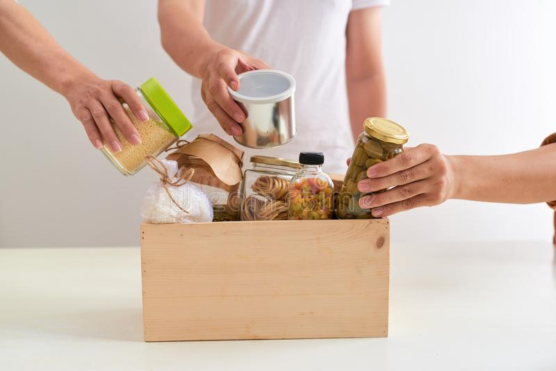 Volunteer with box of food for poor. Donation concept. Volunteer with box of food for poor. Donation concept stock image