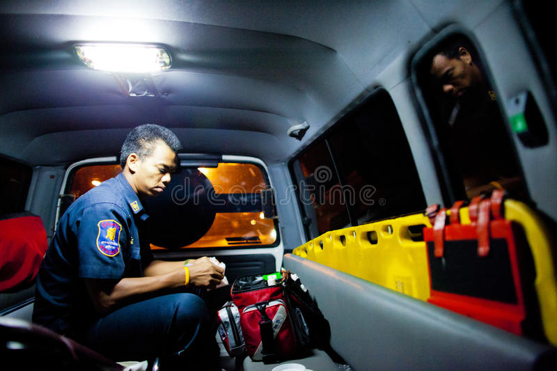 Volunteer EMTs. EMT check his medical supply preparing for next emergency call, February 06, 2010. This EMT is part of Sawang Prateep Volunteer Rescue Team royalty free stock images