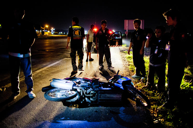 Volunteer EMTs. EMT gathers around motocycle that involvs in an accident after the wounded has been transported, February 06, 2010. These EMTs are part of Sawang royalty free stock images