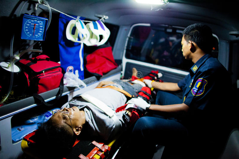 Volunteer EMTs. EMT and injured from motocycle accident inside an ambulance on their way to nearest hospital, February 07, 2010. This is the case of motocycle vs stock image