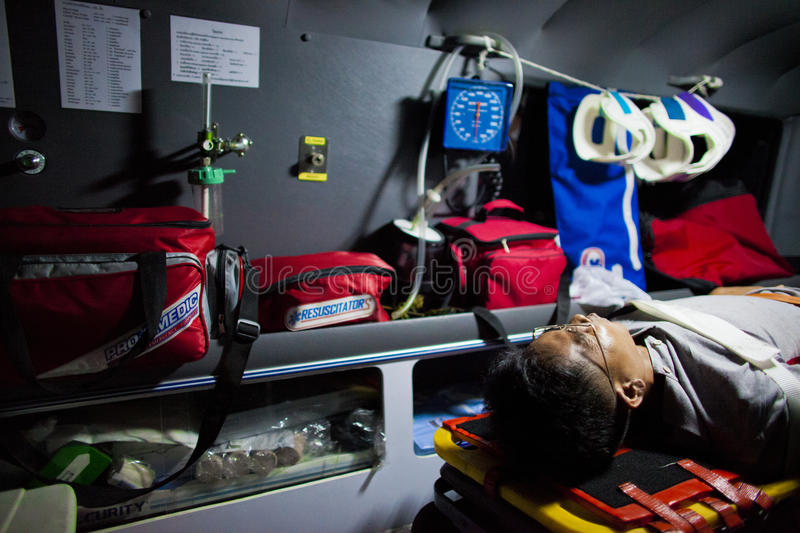 Volunteer EMTs. An injured lying inside an ambulance after involved in motocyled accident, February 07, 2010. This is the case of motocycle vs motocycle. This royalty free stock images