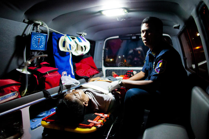 Volunteer EMTs. An injured motorcycle driver lies on a stretcher inside a Sawang Prateep`s ambulance royalty free stock photo