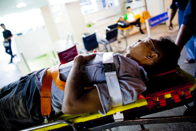 Volunteer EMTs. An injured motorcycle driver is tranported from ambulance to hospital by a stretcher royalty free stock images