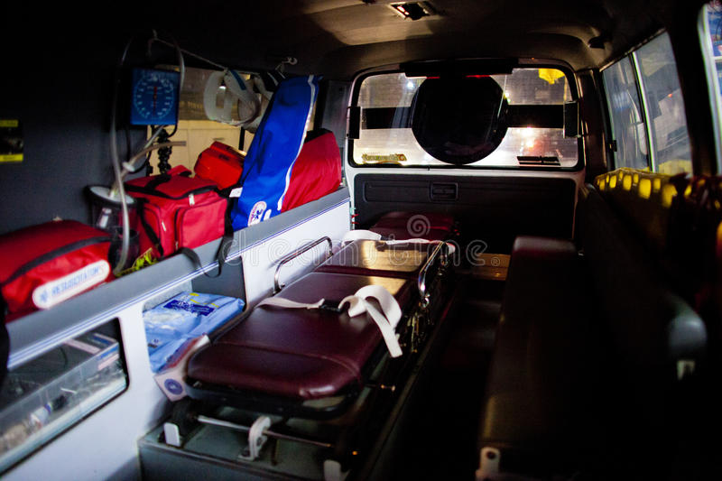 Volunteer EMTs. Inside of an ambulance on standby during night shift, February 06, 2010. The ambulance is fitted with all standard medical equipment stock images