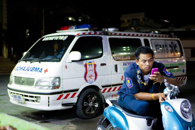 Volunteer EMTs. A member of Sawang Prateep Emergency Medical Service uses his mobile phone during his night shift. Sawang Prateep is one of many volunteer stock image