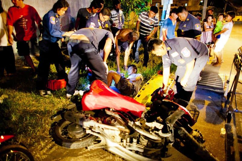 Volunteer EMTs. Members of Sawang Prateep Emergency Medical Service attend to an injured motorcycle driver royalty free stock photo