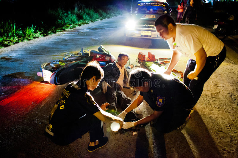 Volunteer EMTs. EMTs are preparing injured of motocycle accident for transport, February 06, 2010. This is the case of motocycle vs motocycle. These EMTs are stock photo