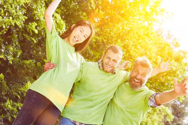 Volunteer environmentalists as a team. In summer in nature royalty free stock image
