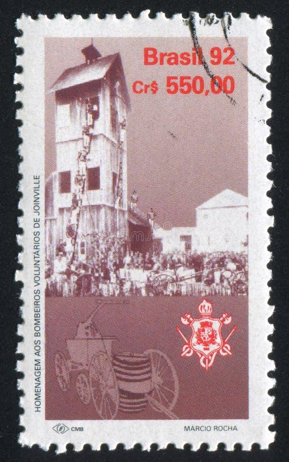 Volunteer firemen of Joinville. BRAZIL - CIRCA 1992: stamp printed by Brazil, shows Volunteer firemen of Joinville, circa 1992 royalty free stock image