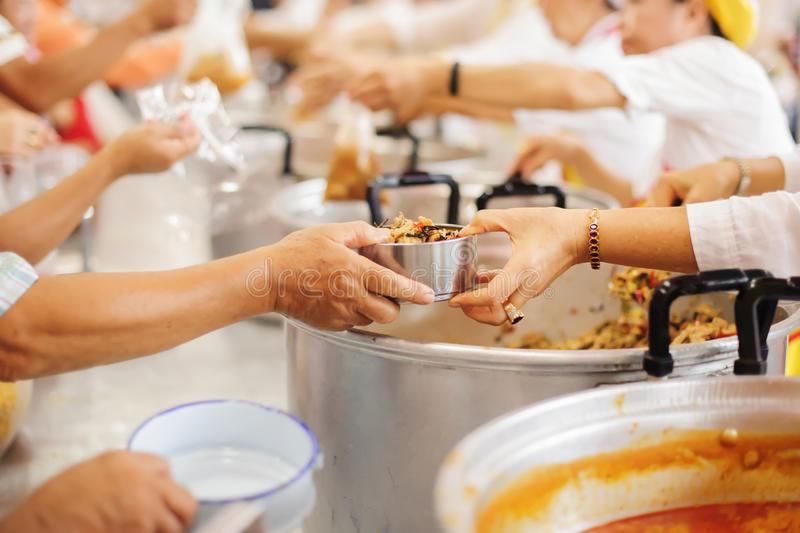 Volunteer food servers dish out a free charity : concept of helping stock photo