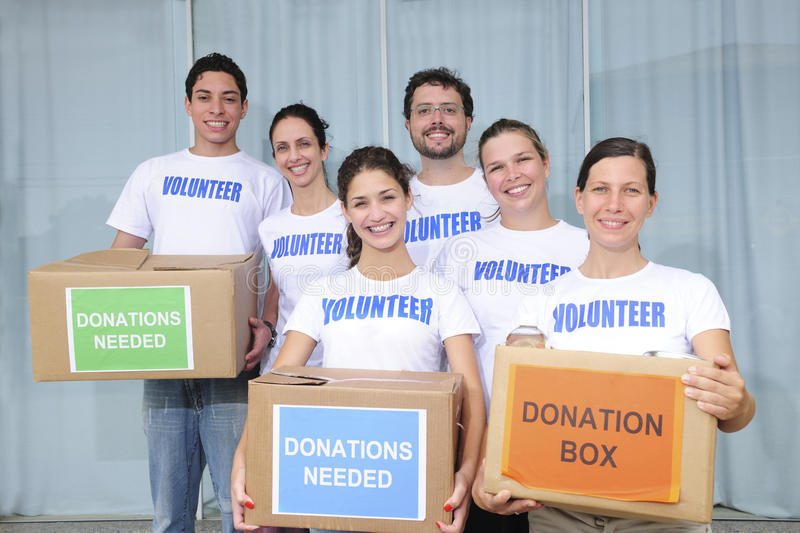 Volunteer group with food donation royalty free stock photos