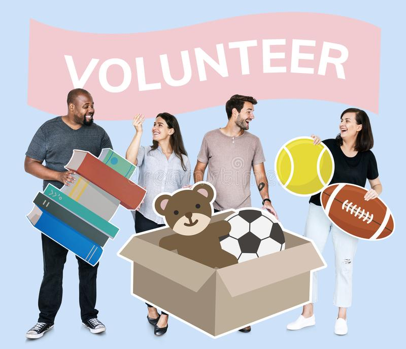 Volunteers donating stuff to a charity. Volunteers donating things to charity royalty free stock photo