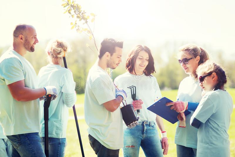 Group of volunteers planting trees in park stock photo