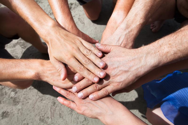 Volunteering or teamwork concept, team gathering hands royalty free stock images