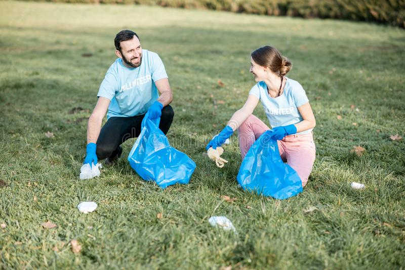 Volunteers cleaning public park from the rubbish royalty free stock photo