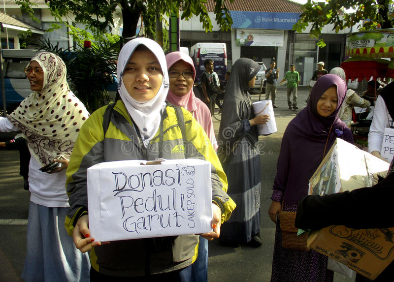 Volunteers. Are collecting donations for disaster victims in the city of Solo, Central Java, Indonesia stock photography