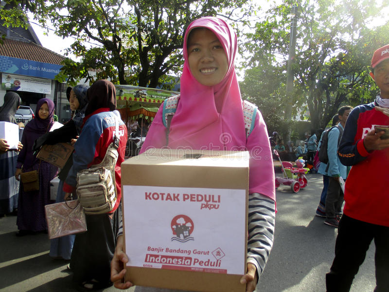 Volunteers. Are collecting donations for disaster victims in the city of Solo, Central Java, Indonesia stock photos