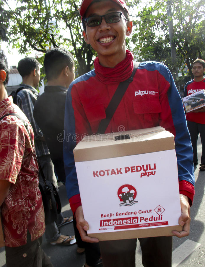 Volunteers. Are collecting donations for disaster victims in the city of Solo, Central Java, Indonesia royalty free stock image