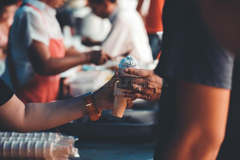 Volunteers give food to the poor to alleviate hunger : the concept of giving food.  royalty free stock photos