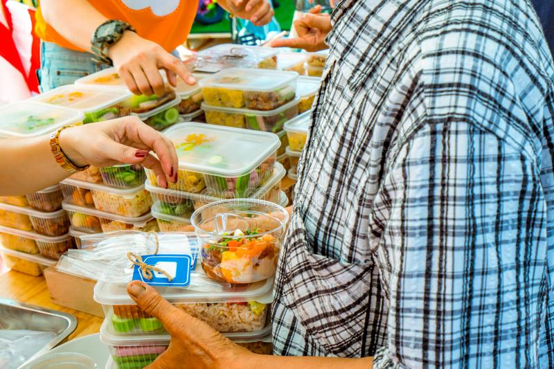 Volunteers giving food to poor people. Poverty concept. royalty free stock image
