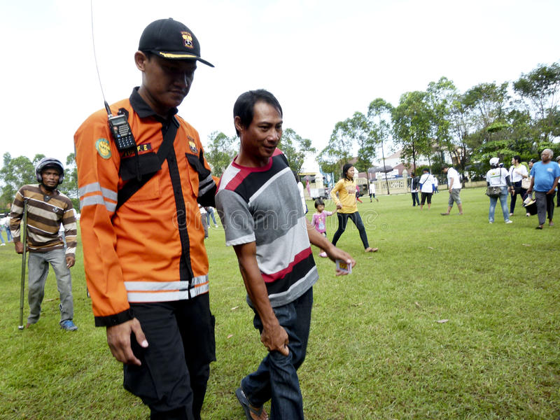Volunteers. Are guiding people with disabilities to receive food aid in the city of Solo, Central Java, Indonesia royalty free stock photo