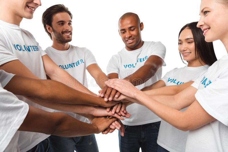 Volunteers making team gesture royalty free stock photo