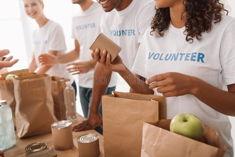 Volunteers packing food and drinks for charity stock photography