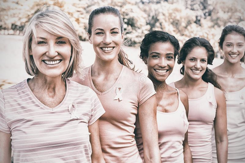 Volunteers participating in breast cancer awareness. Group of female volunteers participating in breast cancer awareness stock photography