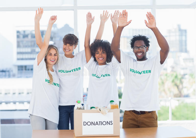 Volunteers raising their arms royalty free stock photos