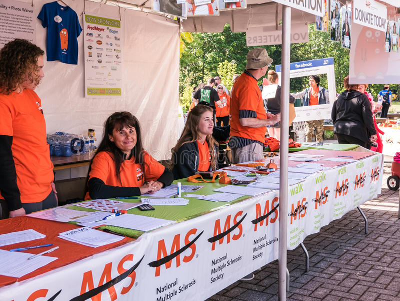 Volunteers at registration table for Walk MS Oregon, spring 2015, Corvallis stock photography