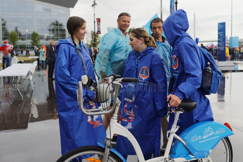 Volunteers at Saint Petersburg Stadium during FIFA World Cup Russia 2018. St. Petersburg, Russia - June 19, 2018: Host city volunteers talking with fans at Saint royalty free stock photography
