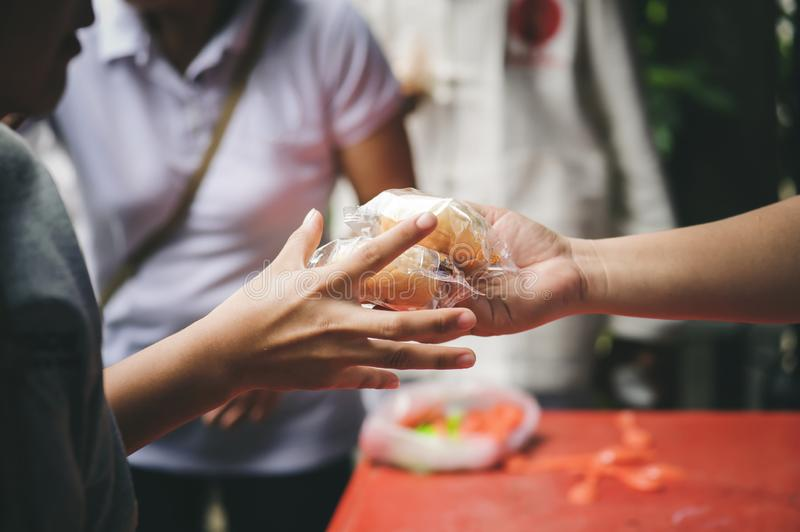 Volunteers serving food for poor people : concept of free food serving.  royalty free stock images