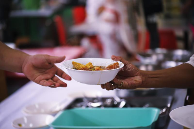 Volunteers Share Food to the Poor to Relieve Hunger: Charity concept.  stock photography