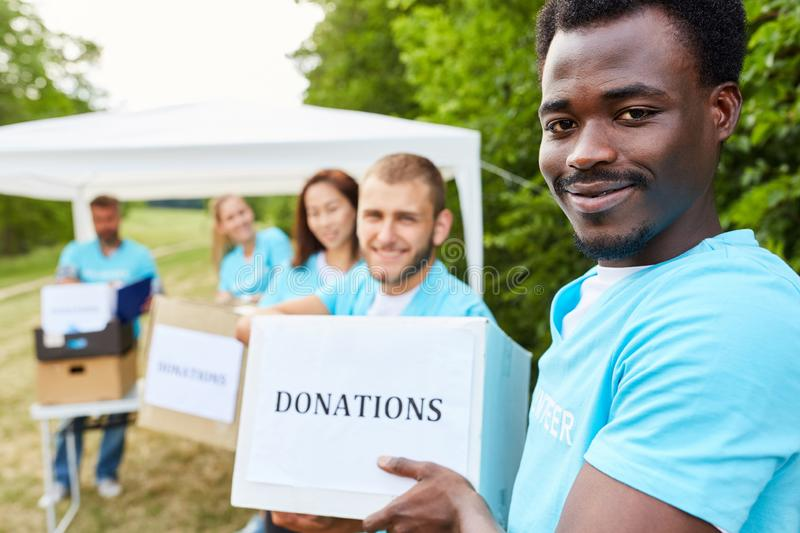 Volunteers work as a team stock photography
